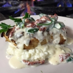 Herb Encrusted Grouper over garlic risotto topped with a sundried tomato & spinach garlic cream.