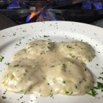 Homemade Ravioli stuffed with veal, roasted red peppers, spinach and ricotta cheese topped with Marsala cream.