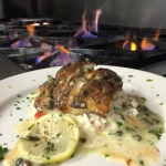 Blackened Grouper over garlic risotto with lemon caper butter.