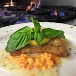 Herb encrusted Grouper over roasted red pepper risotto with lemon butter.