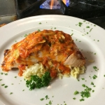 Grilled Salmon with Parmesan orzo and roasted red pepper and artichoke butter.