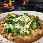 Artisan Garlic flatbread with spinach and Gorgonzola.
