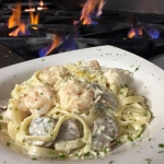 Shrimp Ala Limone' - Sautéed sweet Georgia Shrimp with Italian sausage and lemon cream tossed with fettuccine.