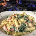 Fresh Georgia Shrimp sautéed with spinach & roasted red peppers in a garlic cream sauce tossed with penne.
