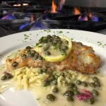 Grouper Francese - Grouper dipped in egg and sautéed over Parmesan orzo with lemon caper butter.