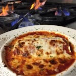 Lobster Cannelloni stuffed with fresh Maine Lobster, Marsala mushrooms,spinach and ricotta cheese with marinara topped with mozzarella cheese.
