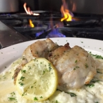 Crab stuffed Flounder over spinach risotto with lemon butter.