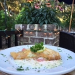 Flounder Francese - Fresh Flounder dipped in egg and sautéed over garlic risotto topped with lemon caper butter.