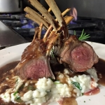 Rack of Lamb over spinach risotto with rosemary and red wine reduction.