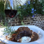 Braised Beef short rib slow cooked with rosemary and red wine served over mushroom risotto.