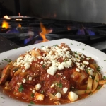 Fresh Georgia Shrimp sauteed with mushrooms and sweet italian sausage tossed with marinara and fettucini, topped with feta.