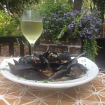 PEI Mussels in garlic white wine butter with diced Roma tomatoes.