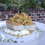 Yellowfin Tuna panseared rare over garlic risotto with a pineapple soy & mango relish.