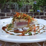 Panseared yellowfin Tuna with rice noodles & sautéed vegetables with a pineapple & soy glaze.