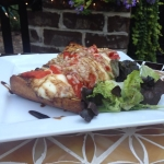 Bruschetta with Roasted red peppers, Mozzarella cheese and Asiago cheese on rustic bread with balsamic reduction.